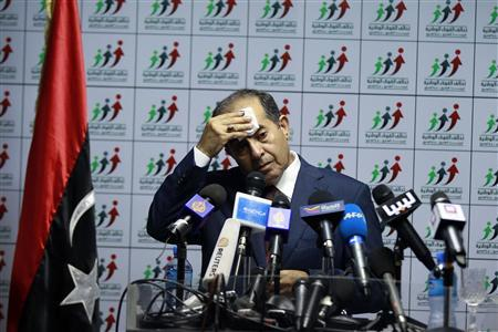 Mahmoud Jibril, head of the National Forces Alliance, wipes perspiration from his brow during a news conference at his party's headquarters in Tripoli July 8, 2012. REUTERS/Zohra Bensemra