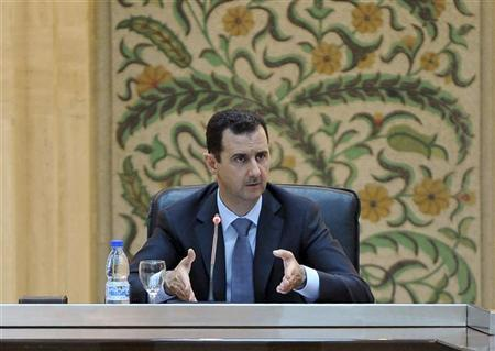 Syria's President Bashar al-Assad speaks to the new government in Damascus in this handout photo distributed by Syrian News Agency (SANA) June 26, 2012. REUTERS/SANA/Handout