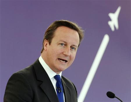 Britain's Prime Minister David Cameron speaks at the Farnborough Airshow 2012 in southern England July 9, 2012. REUTERS/Luke MacGregor