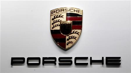 The Porsche Motor Company logo is seen on a wall at the Qatar International Motor Show in Doha January 27, 2012. REUTERS/Fadi Al-Assaad