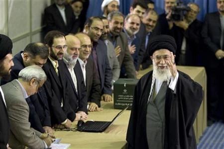 Iran's Supreme Leader Ayatollah Ali Khamenei waves to the media after presenting his identification papers to cast his ballot in the parliamentary election in Tehran March 2, 2012. REUTERS/Caren Firouz