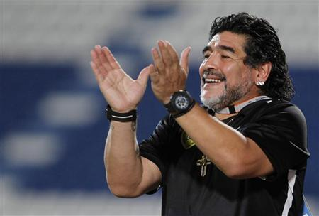 Argentine soccer legend Diego Maradona, coach of UAE's Al-Wasl, claps after his team scored against Qatar's Al Khor during their GCC Champions League soccer match in Doha May 30, 2012. REUTERS/Mohammed Dabbous