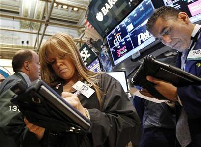 Traders work at the post that trades Procter & Gamble Co. on the floor of the New York Stock Exchange in this June 20, 2012, file photo. REUTERS/Brendan McDermid/Files