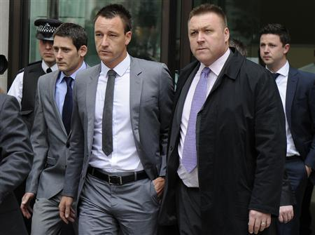 Chelsea football player John Terry (C) leaves Westminster magistrates court, London, July 13, 2012. Former England captain John Terry was found not guilty of racially abusing fellow player Anton Ferdinand on Friday after a five day case which cast a spotlight on racism in soccer and could have had a huge impact on his career. REUTERS/Paul Hackett