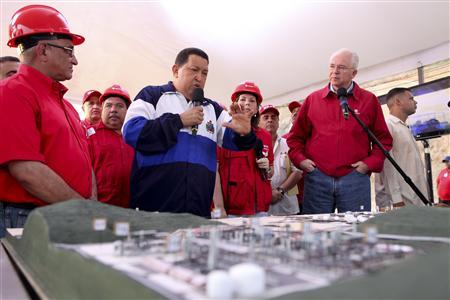 Venezuelan President Hugo Chavez speaks during a visit to an industrial complex in the state of Anzoategui July 13, 2012. REUTERS/Miraflores Palace/Handout