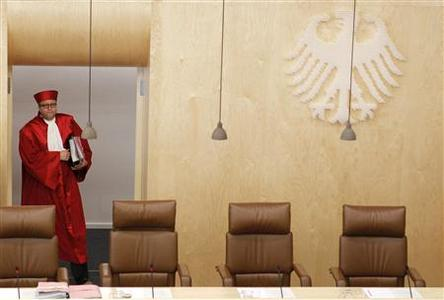 President of the German Constitutional Court Andreas Vosskuhle arrives for the hearing on the European Stability Mechanism (ESM) and the fiscal pact in Karlsruhe in this July 10, 2012 file photo. REUTERS/Alex Domanski/Files