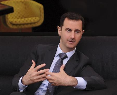 A handout photo distributed by Syrian News Agency (SANA) on July 3, 2012, shows Syria's President Bashar al-Assad during an interview with a Turkish newspaper in Damascus. REUTERS/SANA/Handout
