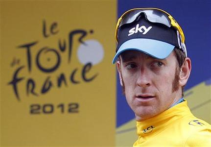 Sky Procycling rider Bradley Wiggins of Britain wears the leader's yellow jersey on the podium after the 17th stage of the 99th Tour de France cycling race between Bagneres-de-Luchon and Peyragudes, July 19, 2012. REUTERS/Stephane Mahe