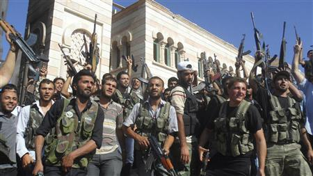 Members of the Free Syrian Army are seen in Azzaz, Aleppo province July 19, 2012. REUTERS/Shaam News Network/Handout