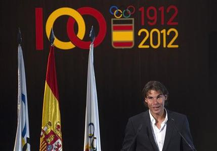 Tennis player Rafael Nadal, the official Spanish flag barrier at the London Olympics, speaks during a handover ceremony in Madrid in this file photo taken July 14, 2012. REUTERS/Juan Medina