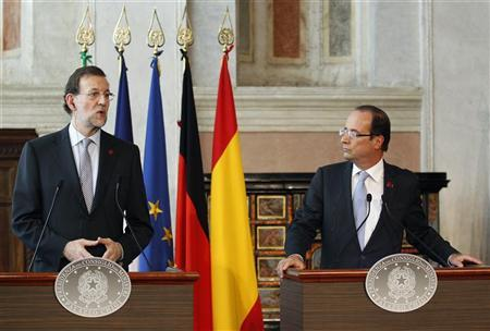 Spanish Prime Minister Mariano Rajoy (L) speaks next to French President Francois Hollande during a news conference at Villa Madama in Rome, June 22, 2012. REUTERS/Max Rossi