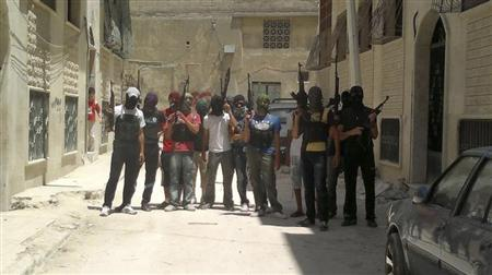 Syrian rebel fighters pose for a picture in Hama July 20, 2012. Picture taken July 20, 2012. REUTERS/Shaam News Network/Handout