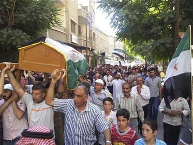 Residents carry the coffin of Muhammad Mousa, whom protesters say was killed by forces loyal to Syria's President Bashar al-Assad, during his funeral in Yabroud near Damascus July 21, 2012. REUTERS/Shaam News Network/Handout