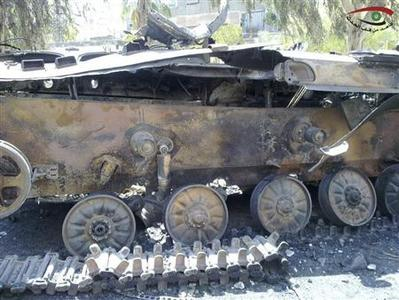 A damaged tank is seen in the suburb of Erbeen in Damascus July 22, 2012. REUTERS/Shaam News Network/Handout
