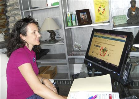 Mila de Mier at her office desk, looking at her internet petition as the signature numbers grow close to the 100,000 mark. De Mier leads a group of Key West residents who have campaigned against the idea of the Florida Keys Mosquito Control unit using genetically-modified mosquitoes in the fight to eradicate dengue fever. Wary of the potential threat to its vital tourism industry, the Florida Keys Mosquito Control unit spends $1 million a year on eradication efforts and is constantly on the lookout for dengue, a potentially fatal virus with extreme flu-like symptoms that is spread by the Aedes aegypti mosquito. REUTERS/Michael Haskins