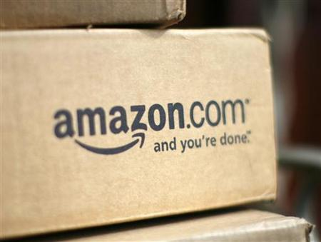 A box from Amazon.com is pictured on the porch of a house in Golden, Colorado July 23, 2008. Online retailer Amazon.com Inc said on Wednesday its quarterly profit doubled on a 41 percent rise in revenue, sending its shares up more than 6 percent. REUTERS/Rick Wilking