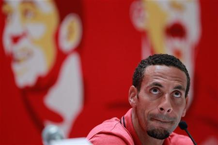 Manchester United's Rio Ferdinand attends a news conference in Shanghai, July 23, 2012. REUTERS/Aly Song