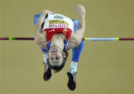 Ivan Ukhov of Russia clears the bar in the men's high jump final during the world indoor athletics championships at the Atakoy Athletics Arena in Istanbul March 11, 2012. REUTERS/Dylan Martinez