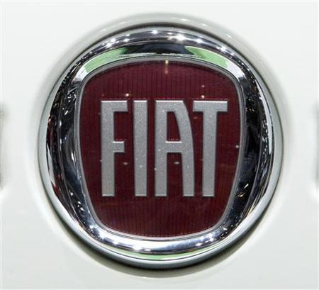 The Fiat logo is displayed during the second media day of the 80th Geneva Car Show at the Palexpo in Geneva March 3, 2010. REUTERS/Denis Balibouse