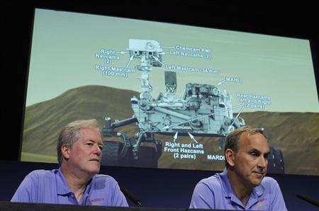 Michael Meyer (L), lead scientist for NASA's Mars Exploration Program, and John Grotzinger, Mars Science Laboratory project scientist, California Institute of Technology look on during a news conference at NASA's Jet Propulsion Lab in Pasadena, Calfiornia August 2, 2012. A graphic of the MSL Curiousity rover and the cameras on board is seen in the background. The rover is set to land in the late evening of August 5, 2012. REUTERS/Fred Prouser