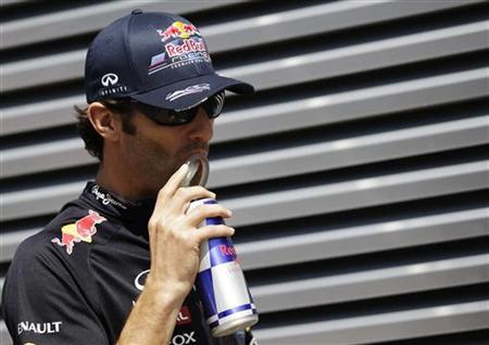 Red Bull Formula One driver Mark Webber of Australia walks in the paddock ahead of the Hungarian F1 Grand Prix at the Hungaroring circuit near Budapest July 29, 2012. REUTERS/Leonhard Foeger