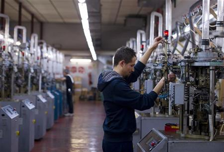 An employee works in a stocking factory in Calvisano near Brescia, northern Italy December 6, 2011. Reuters/Paolo Bona