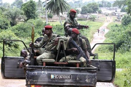 Ivory Coast Republican forces (FRCI) patrol near Sacre village, in the western Tai area near Ivory Coast's border with Liberia, June 17, 2012. REUTERS/Luc Gnago