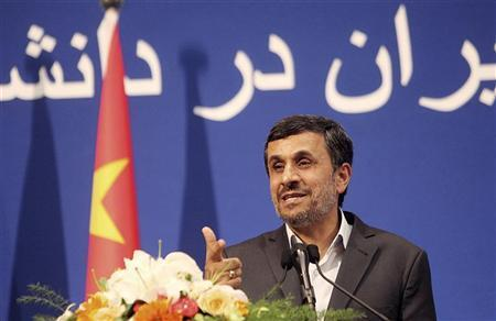 Iranian President Mahmoud Ahmadinejad gestures as he delivers a speech in front of a Chinese national flag at the Peking University in Beijing, June 6, 2012. REUTERS/China Daily