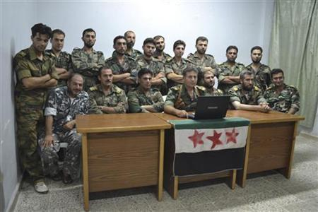 Members of Free Syrian Army, who defected from the regular army, are seen in Kafranbel, near Idlib Syria July 28, 2012. REUTERS/Shaam News Network/Handout