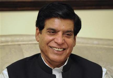 Pakistan's Prime Minister-elect Raja Pervez Ashraf smiles during a meeting with Chaudhry Shujaat Hussain (not in picture) head of coalition party Pakistan Muslim League Quaid (PML-Q) in Islamabad June 22, 2012. REUTERS/Stringer