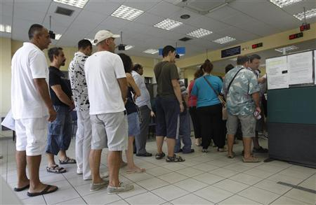 People line up inside an unemployment bureau in Athens September 6, 2012. REUTERS/John Kolesidis