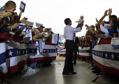 Romney holding babies