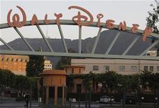 <p>La Walt Disney Company a publié jeudi un bénéfice net en hausse de 14% à 1,2 milliard de dollars au titre de son quatrième trimestre clos le 29 septembre, grâce notamment à de bons résultats de ses parcs à thème et du réseau ESPN de chaînes sportives. /Photo prise le 7 mai 2012/REUTERS/Fred Prouser</p>