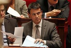 """<p>Le ministre de l'Intérieur Manuel Valls prône mardi dans une interview au Figaro une réforme du mode d'évaluation de la délinquance en l'estimant notamment sur la durée afin de mettre fin """"aux tentations d'arranger les statistiques"""". /Photo prise le 28 novembre 2012/REUTERS/Charles Platiau</p>"""
