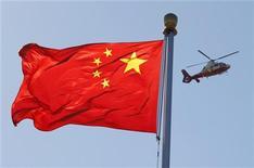 <p>Les investissements directs étrangers (IDE) en Chine ont reflué de 3,6% en janvier-novembre par rapport aux onze premiers mois de 2011, à 100,0 milliards de dollars. /Photo d'archives/REUTERS/David Gray</p>