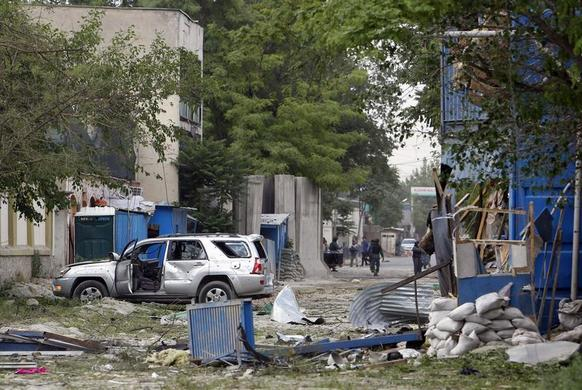 A damaged vehicle is parked at the site of an explosion in Kabul, May 24, 2013. REUTERS-Omar Sobhani