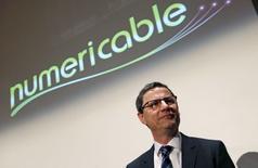Le PDG de Numericable, Eric Denoyer, lors de la présentation des résultats 2013 de l'entreprise, marqués notamment par une hausse des investissements. Il a précisé que Numericable n'aurait pas besoin de céder d'actifs en cas de rachat de SFR auprès de Vivendi. /Photo prise le 12 mars 2014/REUTERS/Jacky Naegelen