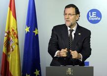 A l'issue du Conseil européen à Bruxelles, le président du gouvernement espagnol, Mariano Rajoy, a déclaré que la croissance économique de son pays pourrait atteindre 1,8% l'année prochaine, alors que Madrid prévoyait jusqu'à présent une expansion de 1,5% en 2015. /Photo prise le 21 mars 2014/REUTERS/Laurent Dubrule