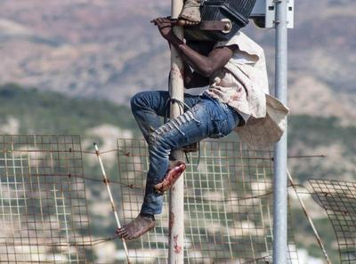 Crossing the razor-wire fence