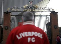 A Liverpool supporter stands in front of the Shankly gates outside Anfield in Liverpool, northern England March 26, 2014. New inquests into the 1989 Hillsborough disaster, that claimed the lives of 96 men, women and children, are scheduled to open on Monday. Photograph taken on March 26, 2014.    REUTERS/Phil Noble (BRITAIN  - Tags: DISASTER SOCIETY SPORT SOCCER)   - RTR3J72J