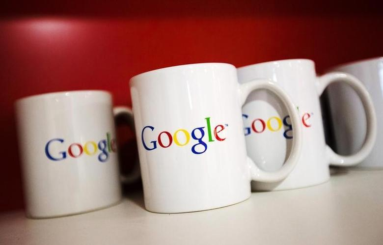 Coffee cups with Google logos are seen at the new Google office in Toronto, November 13, 2012. REUTERS/Mark Blinch/Files