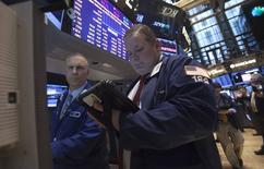 Wall Street a ouvert mardi en hausse. Le Dow Jones gagne 0,13% dans les premiers échanges. Le Standard & Poor's 500 progresse également de 0,13% et le Nasdaq prend 0,24%. /Photo prise le 14 avril 2014/REUTERS/Carlo Allegri