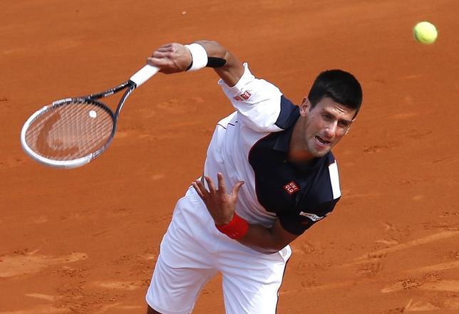 Novak Djokovic of Serbia serves to Albert Montanes of Spain during the Monte Carlo Masters in Monaco April 15, 2014. REUTERS/Eric Gaillard