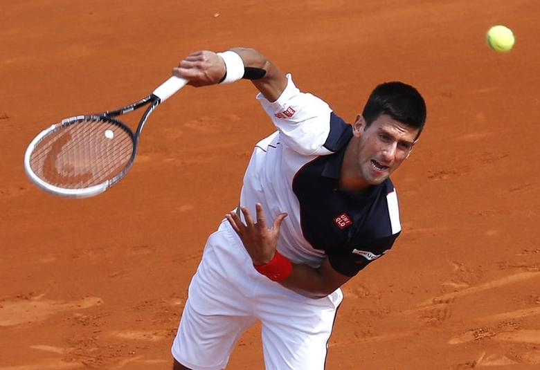 Novak Djokovic of Serbia serves to Albert Montanes of Spain during the Monte Carlo Masters in Monaco April 15, 2014. REUTERS/Eric Gaillard