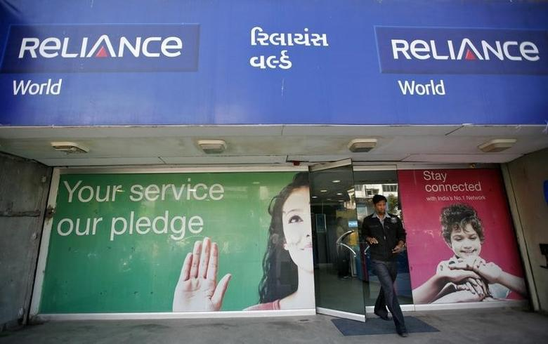 A customer leaves a Reliance communication store in Ahmedabad January 23, 2013. REUTERS/Amit Dave