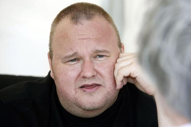 Kim Dotcom talks with supporters at his Internet Party pool party at the Dotcom mansion in Coatesville, Auckland April 13, 2014. REUTERS/Nigel Marple