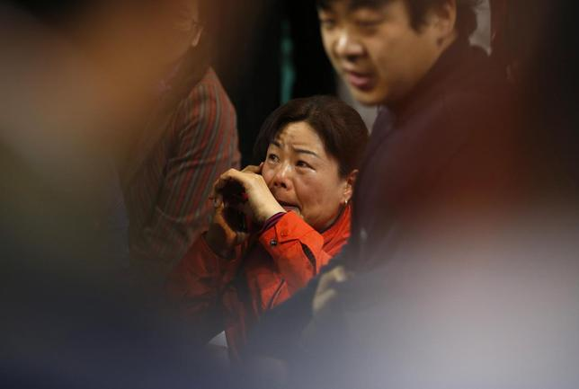 A family member of a missing passenger on the South Korean ferry ''Sewol'' which sank at sea cries as she wait for news from a rescue team at a gym in Jindo April 17, 2014. REUTERS/Kim Hong-Ji