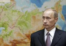 Президент России Владимир Путин на фоне карты России в Ново-Огарёво 10 января 2007 года. Подпись России под мирным соглашением относительно Украины не означает, что Кремль отступил - скорее, президент Владимир Путин готовится достичь своих целей не спеша. REUTERS/ITAR-TASS/PRESIDENTIAL PRESS SERVICE