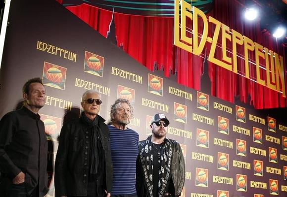 Members of British rock band Led Zeppelin, (from L to R) bass player John Paul Jones, guitarist Jimmy Page, lead singer Robert Plant and drummer Jason Bonham, pose for photographers in New York October 9, 2012. REUTERS/Carlo Allegri/Files