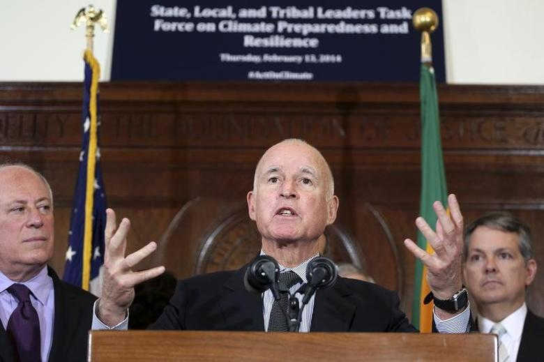 California Gov. Jerry Brown (C) speaks during a media briefing by members of President Barack Obama's Climate Task Force committee in Los Angeles, California February 13, 2014. REUTERS/Jonathan Alcorn